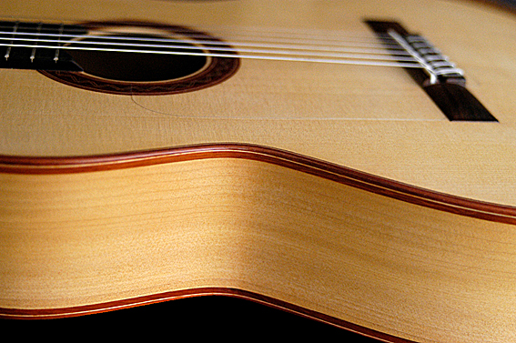 Flamenco guitar shallower neck angle and a lower bridge